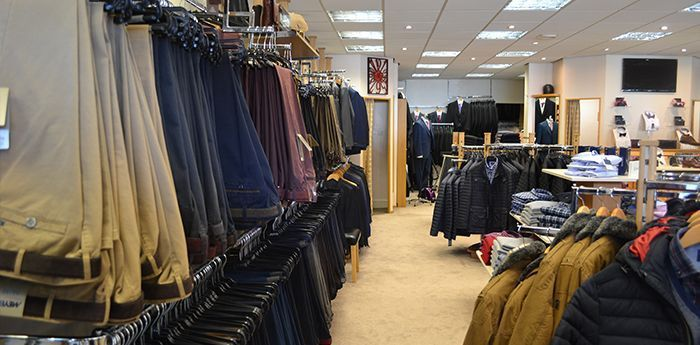 Expert Advice: Inside a full stocked store filled with mens clothes.