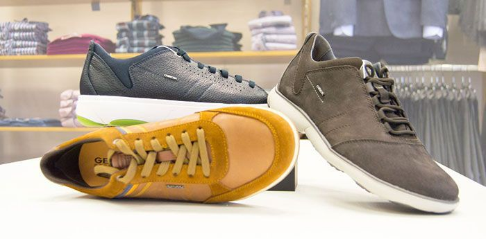Geox Shoes: Three trainers, one blue, one brown and one yellow.
